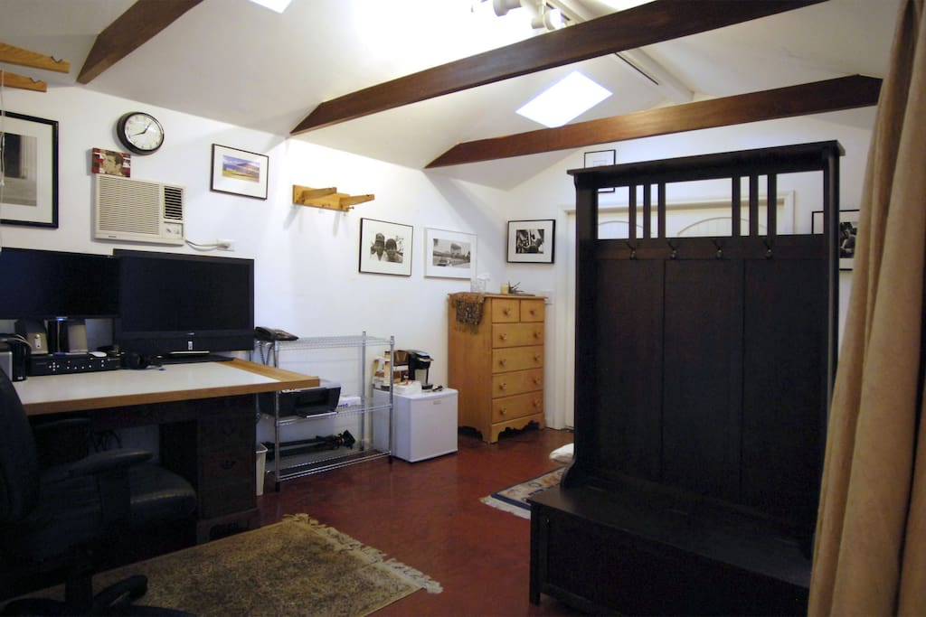 Interior view, walking in the front door. Bed is located behind the coat rack.