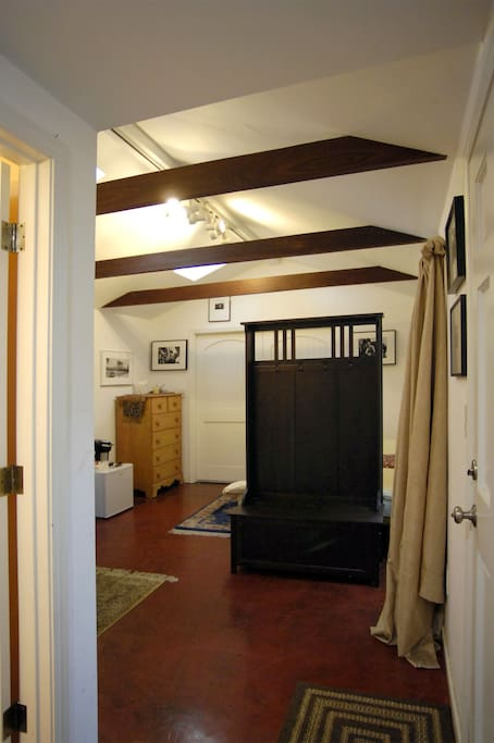 Bathroom entrance visible on left edge of this photo. Front door is visible on right edge of this photo.