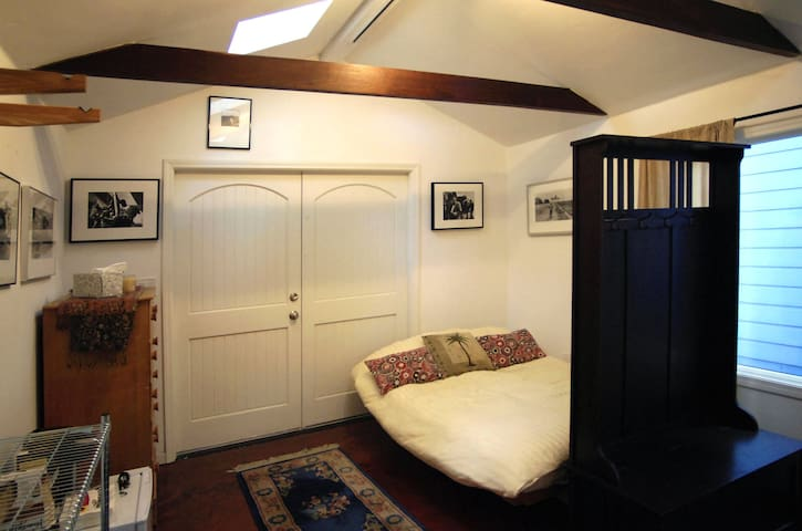 The bed is a relatively new (very comfy) full-sized futon with an oak frame.