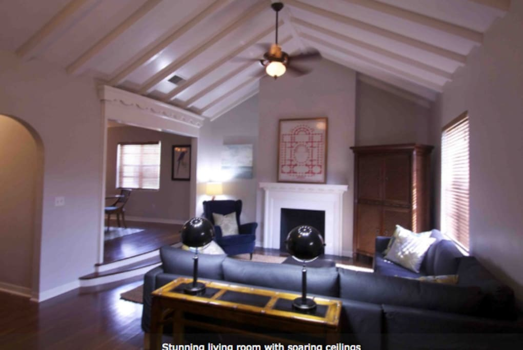 Living room with soaring ceiling. Hardwood throughout