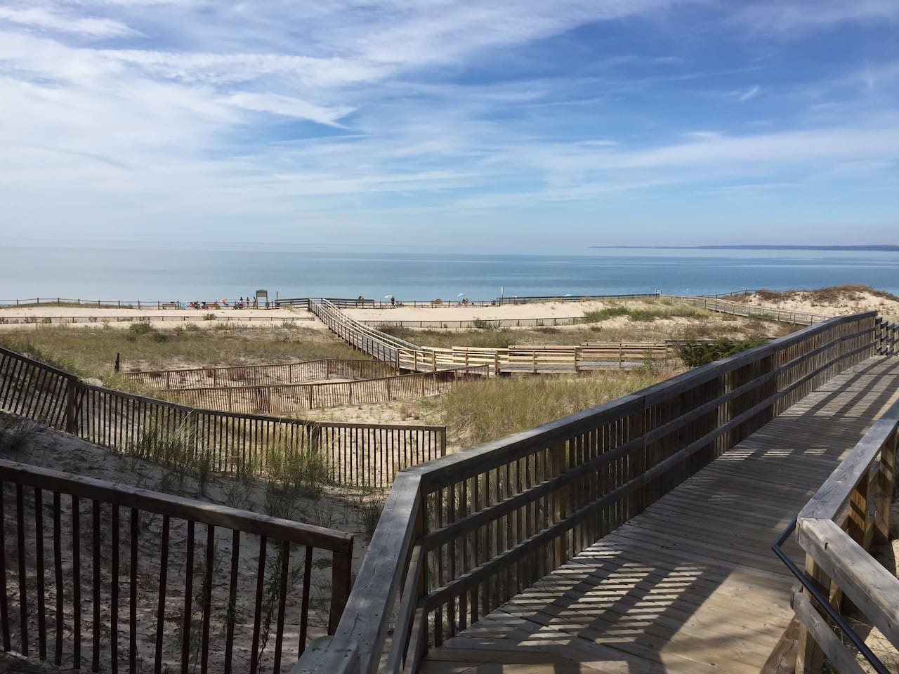 Beautiful powder beach, crystal clear waters, sand dunes and boardwalk are a short 8 minute walk from our home.