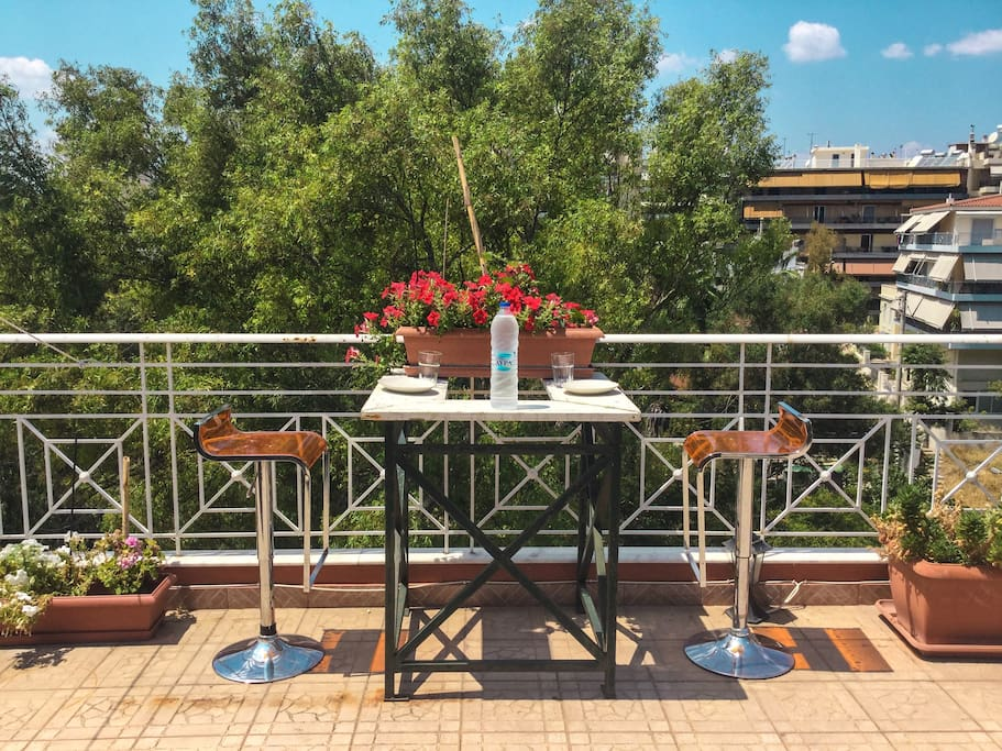 Huge outdoor balcony with breakfast nook and dinning area and vegetable garden