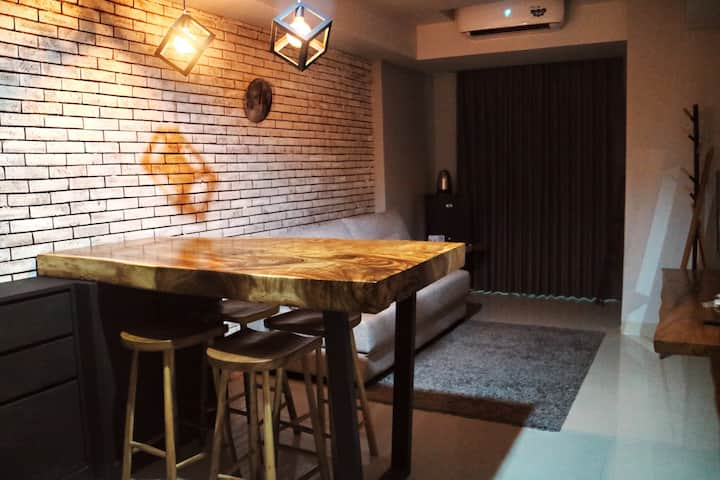 Newly furnished, cozy + chic industrial interior