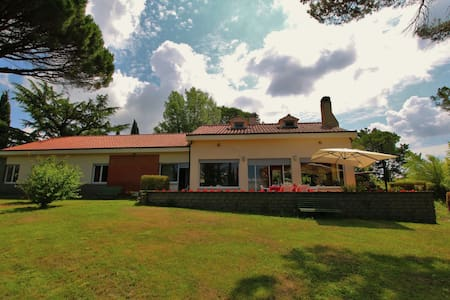 Villa with large garden with view of lake Bolsena
