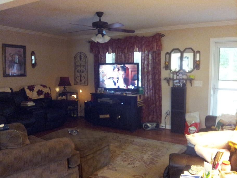 This is front living room with large screen TV and plenty of seating room that is off the kitchen and second living room all open concept.