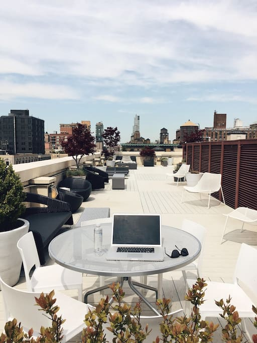 The rooftop is our favorite place to spend time. Whether you want to catch some sun during the day or watch the sunset on warm summer nights, you'll love it. Free Wifi, lots of comfy couches, lounge chairs, cafe tables/chairs, and a view of the city and Hudson River.