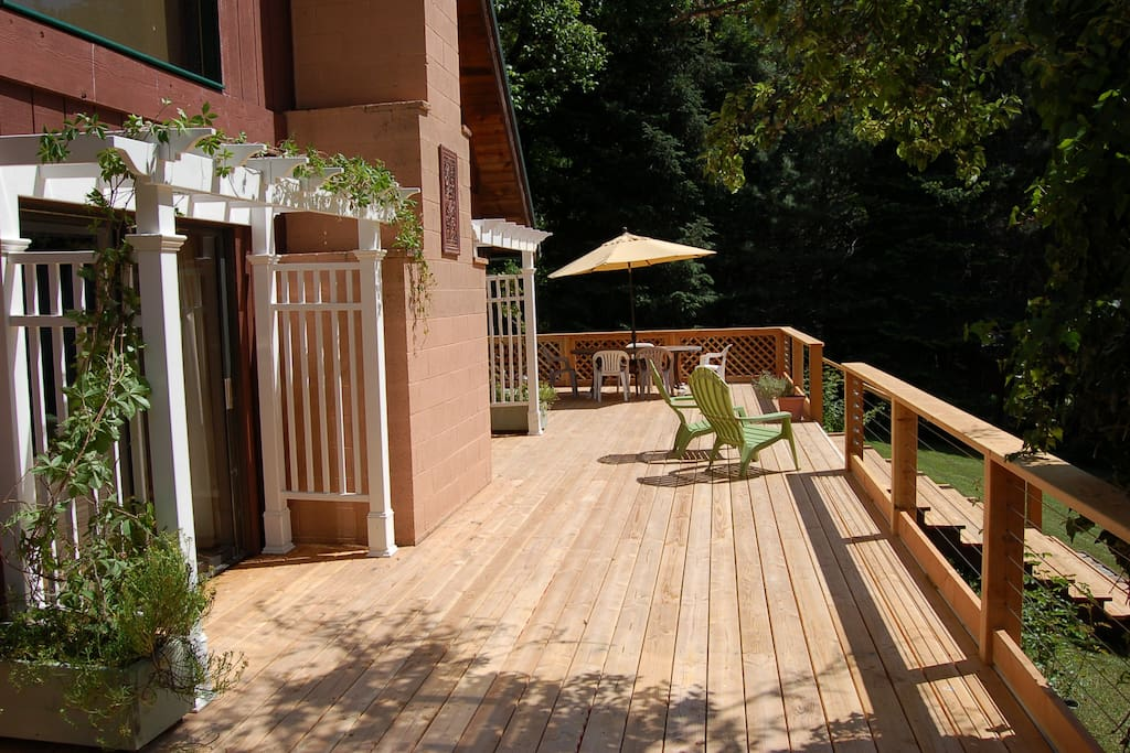 This deck has room to move! Dining set, lounges and comfy chairs add to its appeal
