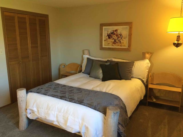 Master bedroom with Queen and large closet. Window air conditioner in this room during the summer.