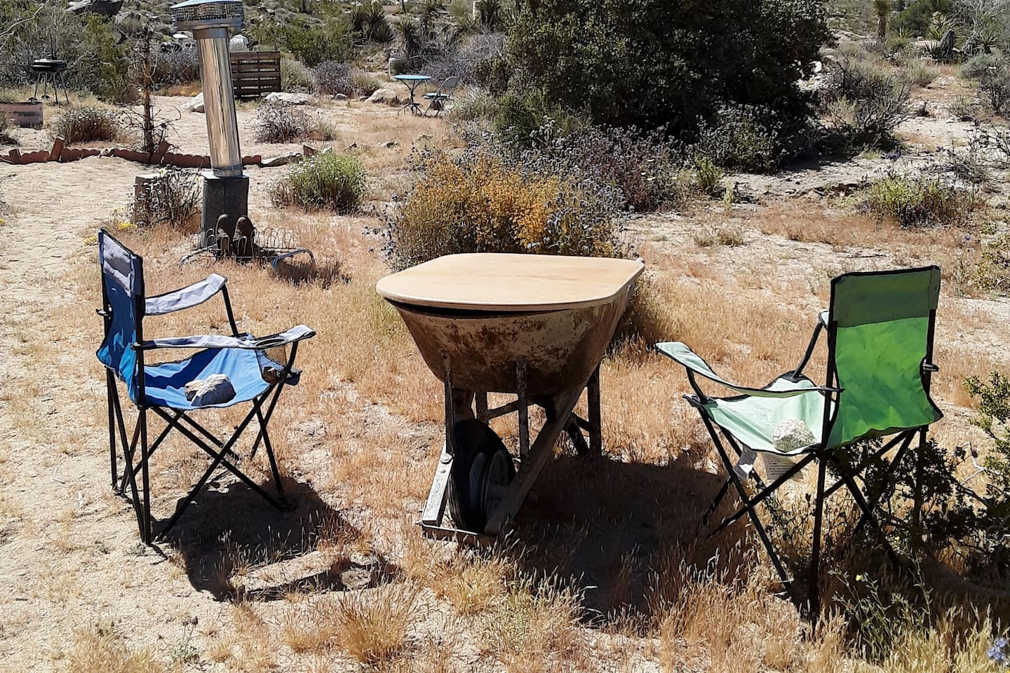 PapaDaddyO campsite has iron board, for your stove, a place to hang your shoes, and a wheel barrel for your table.