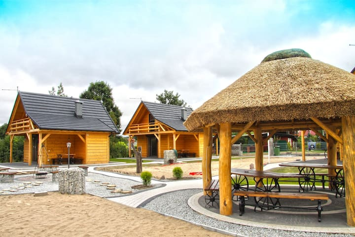 A wooden, eco-friendly house by the Goszcza lake. Living room, 2 bedrooms.