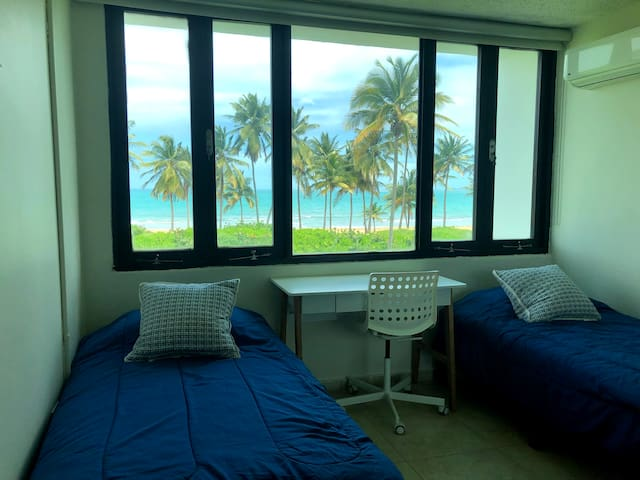 Bedroom 2.  FYI:  That is not a painting in the back, it is our picture perfect view of the ocean!