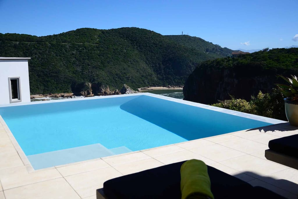 Gaze down from the clear pool onto the famous Knysna Heads