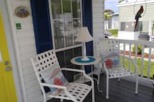 Front porch with a sitting area. Great place to sit and chat with friends and neighbors.