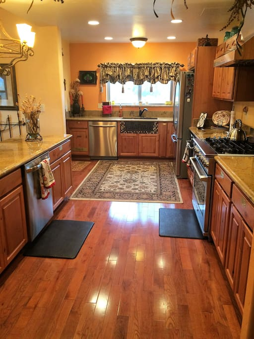 Downstairs: Kitchen -  2 dishwashers, coffee maker.  microwave, 6 burner range.  Small appliances, utensils, dishes, pots n pans; everything you'll need.