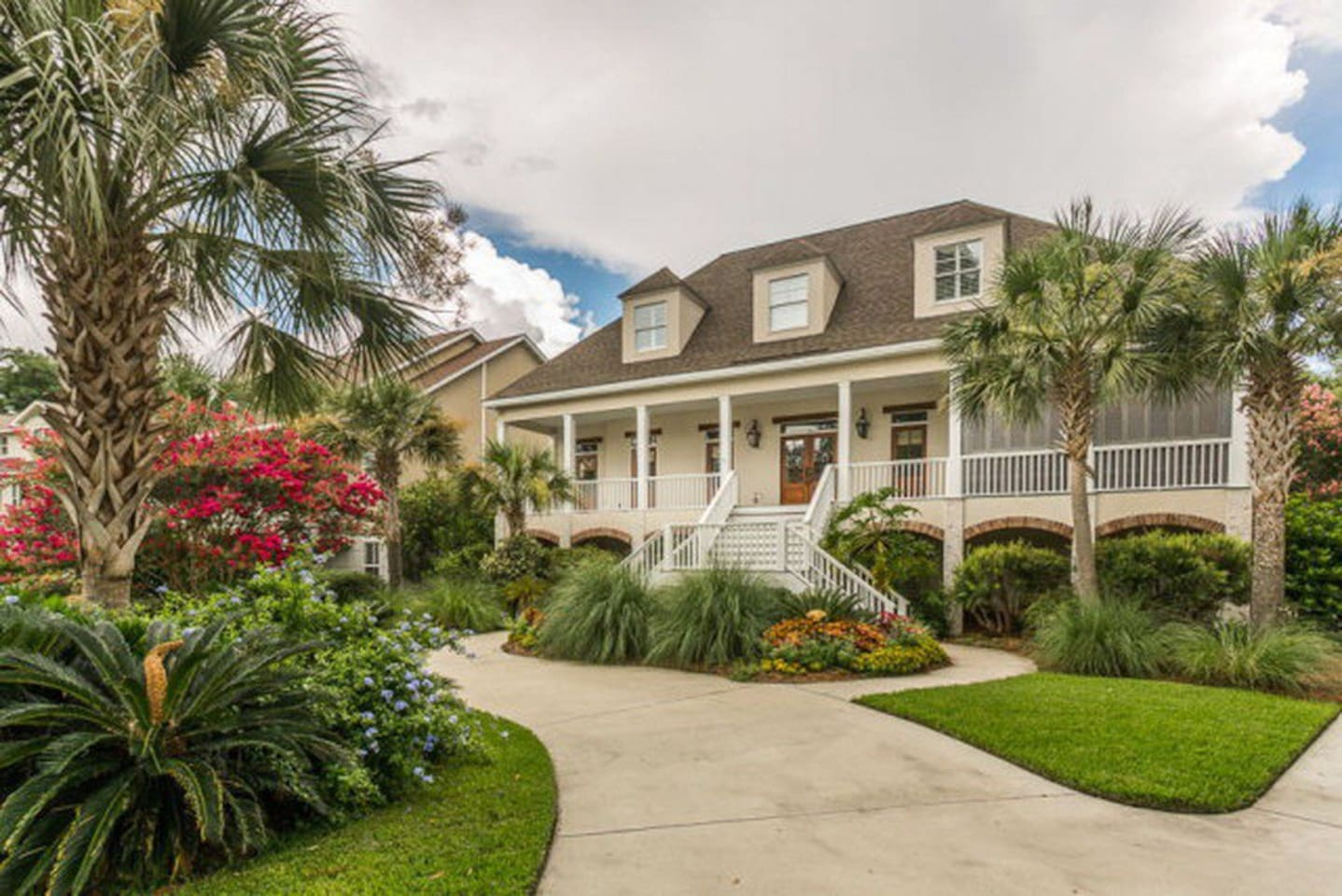 Family home with 5 bedrooms and 4 full bathrooms,  screened in patio, ping pong, darts, outdoor shower, 2.5 miles from beach.  Home does not have an elevator so be ready for stairs.  Living space is on the second and 3rd floors.