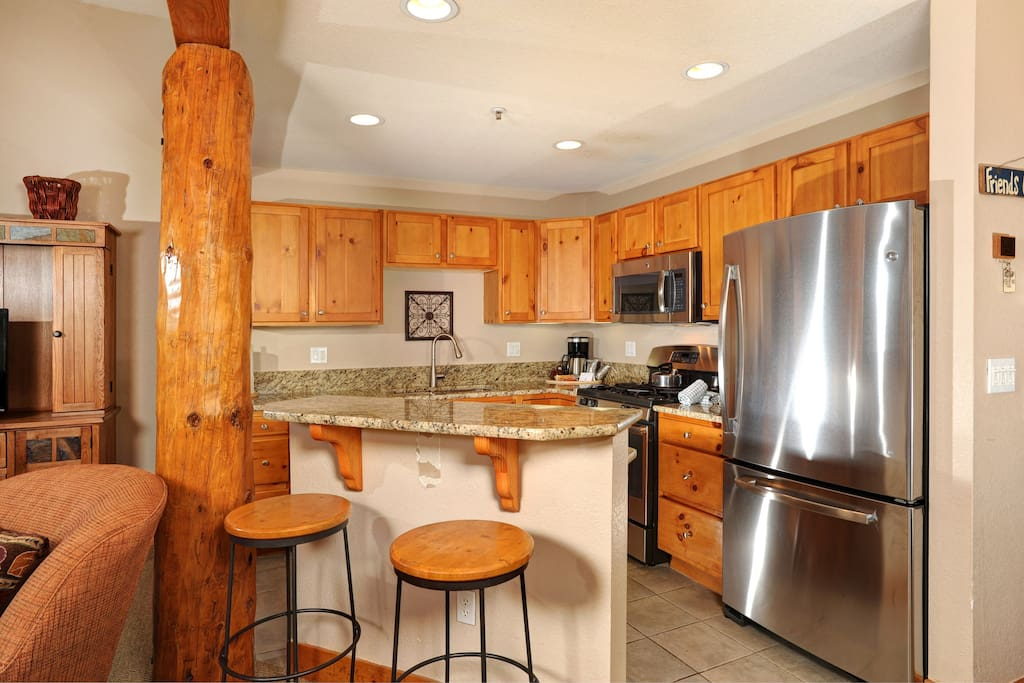 The fully-equipped kitchen includes a breakfast bar