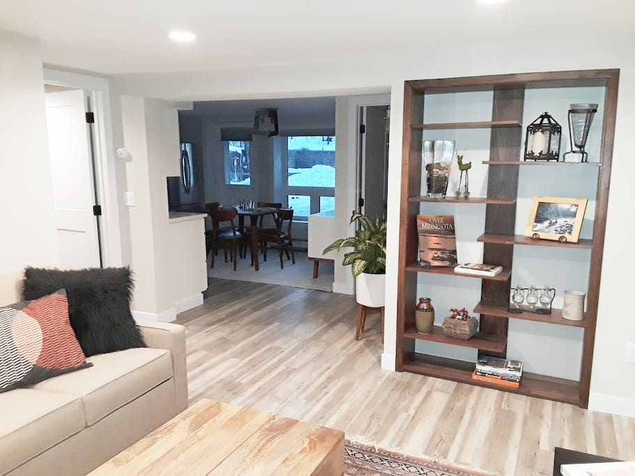This is the view from the living room. Custom made black walnut shelving system, a view of the kitchen, bedroom to the left and perfect bathroom with the most amazing shower in upper right.  Almost 600 square feet of Shangri La.