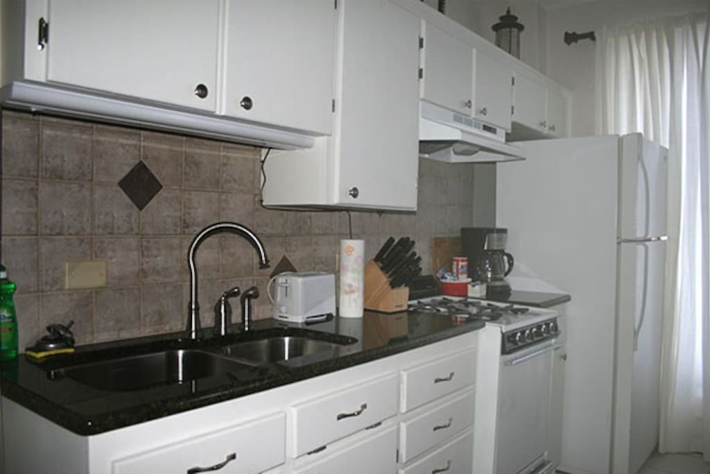 Full kitchen with large pantry.. all utensils.