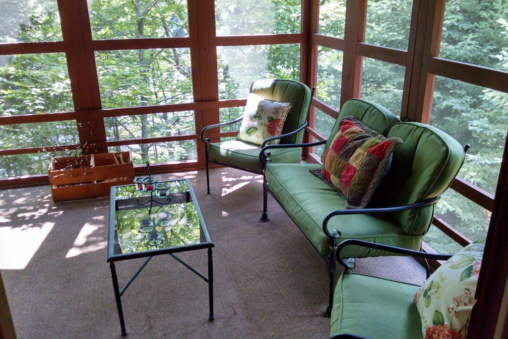 Everyone's favorite place, sleep or dine on screen porch.
