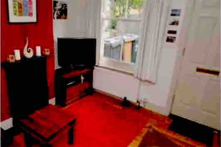 My lounge/free WiFi,sky tv with lots and lots of channels  Floor is now carpeted  Furniture may change
