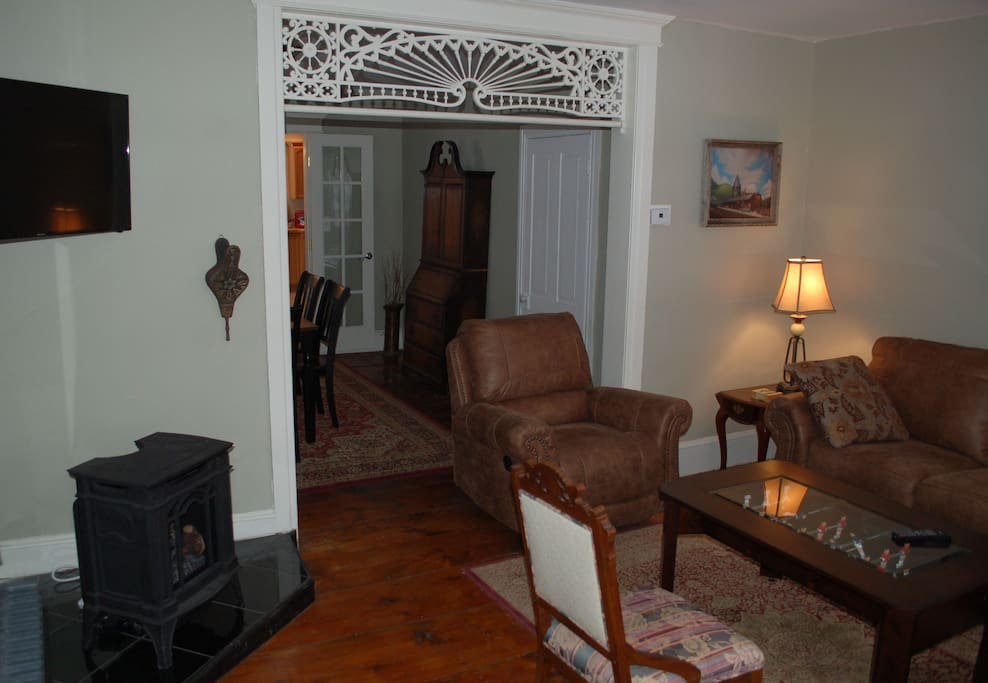 Another angle of living room with realistic gas woodstove