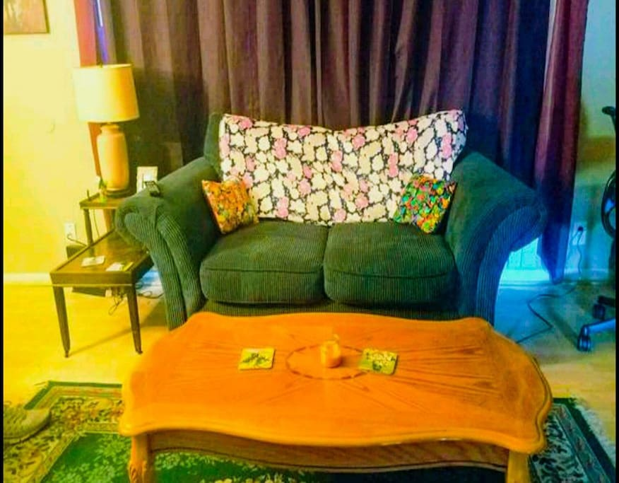 The couch and coffee table in the living room. Get cuddly!