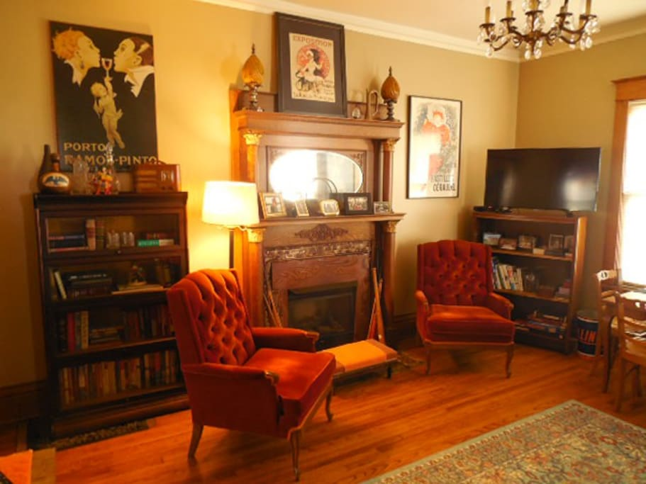 1st floor library with gas log fireplace & flat screen TV