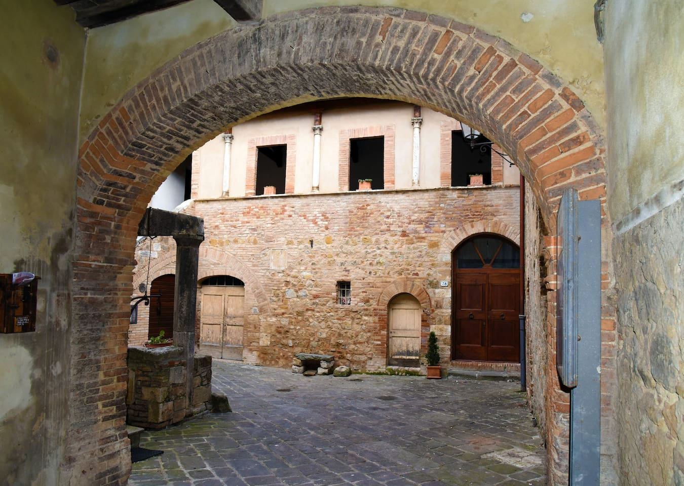 Entrance from courtyard of the well