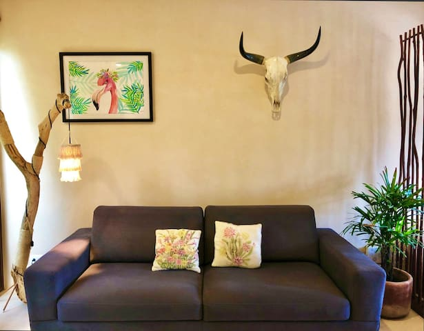 Stylish studio with Yucatan bull head and locally crafted reading lamp / Estudio con estilo y cabeza de toro yucateco  y lámpara para leer hecho a mano