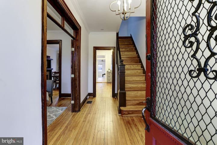 Front entrance reveals original wooden floors and staircase