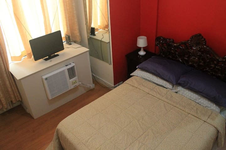 Bedroom with AC and TV with local channels