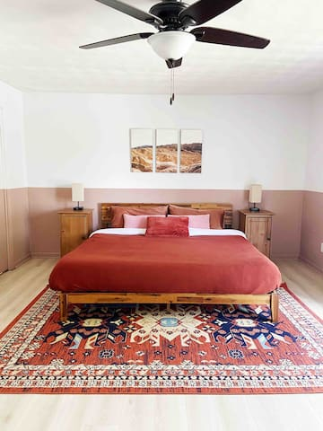 California Desert styled Master bedroom with King size bed. Night stand lights have plug in ports/usb for easy charging.