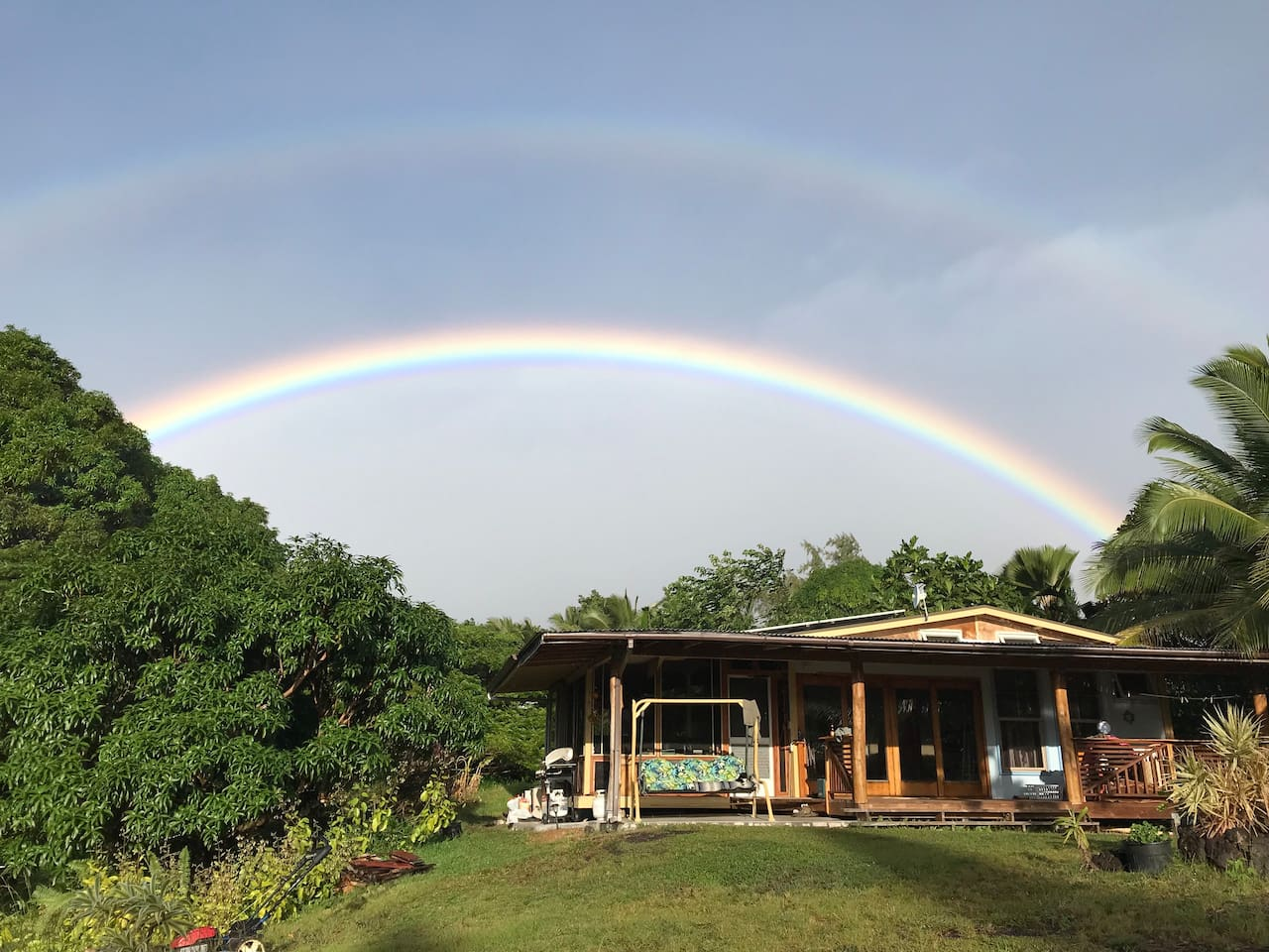 Come and stay over the rainbow or more accurately under it. As the sun rises and brings a morning drizzle there will be a rainbow over the house. Double rainbows are common. This porch swing is one of my favorite chill spots at The Sweet Spot