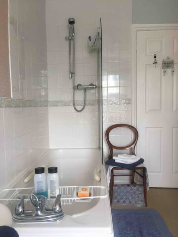 Spacious Private guest bathroom with shower and bath