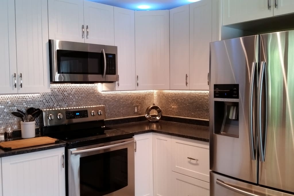 All Brand New Stainless steel appliances.  Water and Ice in Door of Fridge.