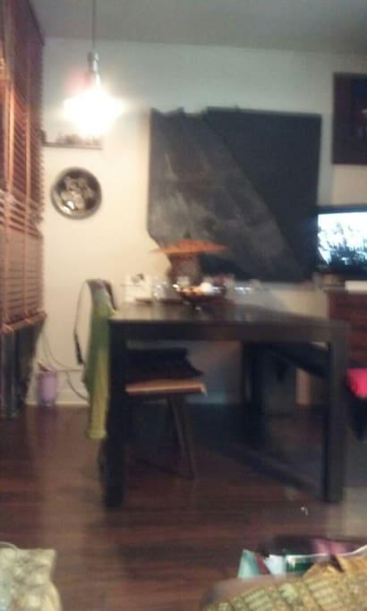 salle a manger proche cuisine et salon d'un tenant
