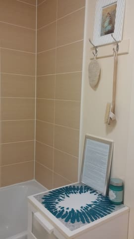 The bathroom with shower and bath