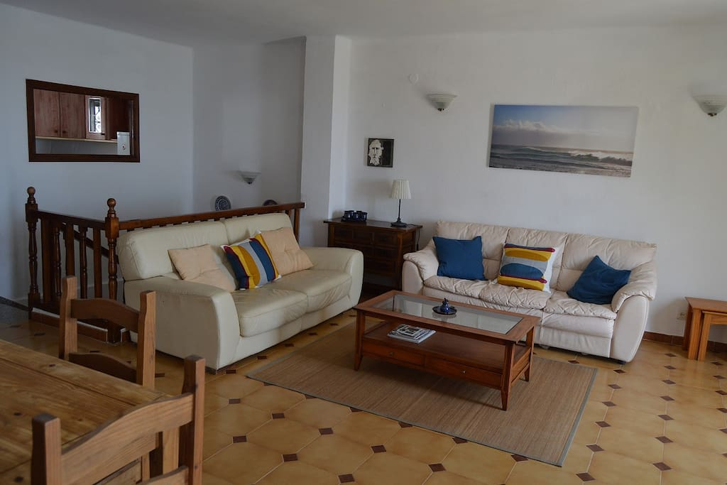 Spacious airy lounge diner with sea and mountain views. Plenty of seating with many channels on the flat screen TV