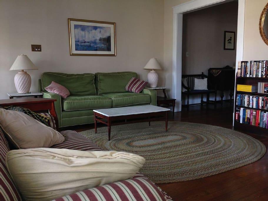 Nor'wester living room has 2 comfy sofas facing HDTV