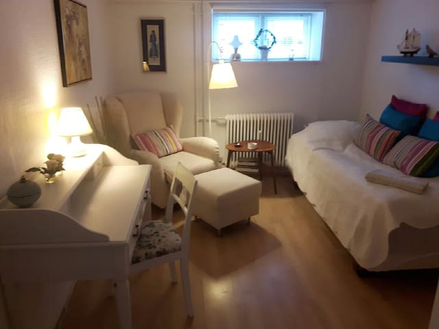 A nice room with access to kitchenette and bath