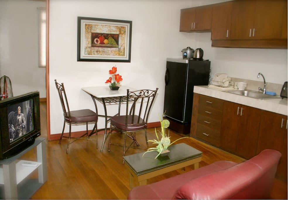 """This listing comes with a spacious dining room. Do you plan on cooking dinner for that special someone? We have all the dining-ware, kitchen-ware, etc that you will need! (Note: The Television was replaced with a 32"""" Flatscreen TV, and moved to the Bedroom)"""