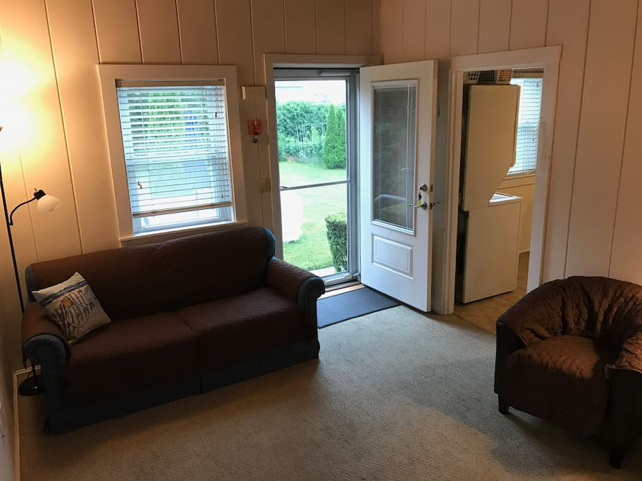 Front door view from inside the living room; kitchen door on the right.