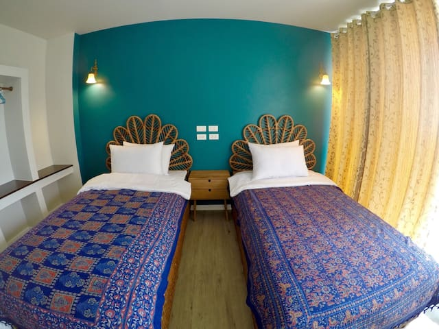 Green hippie room with unforgettable rattan bed