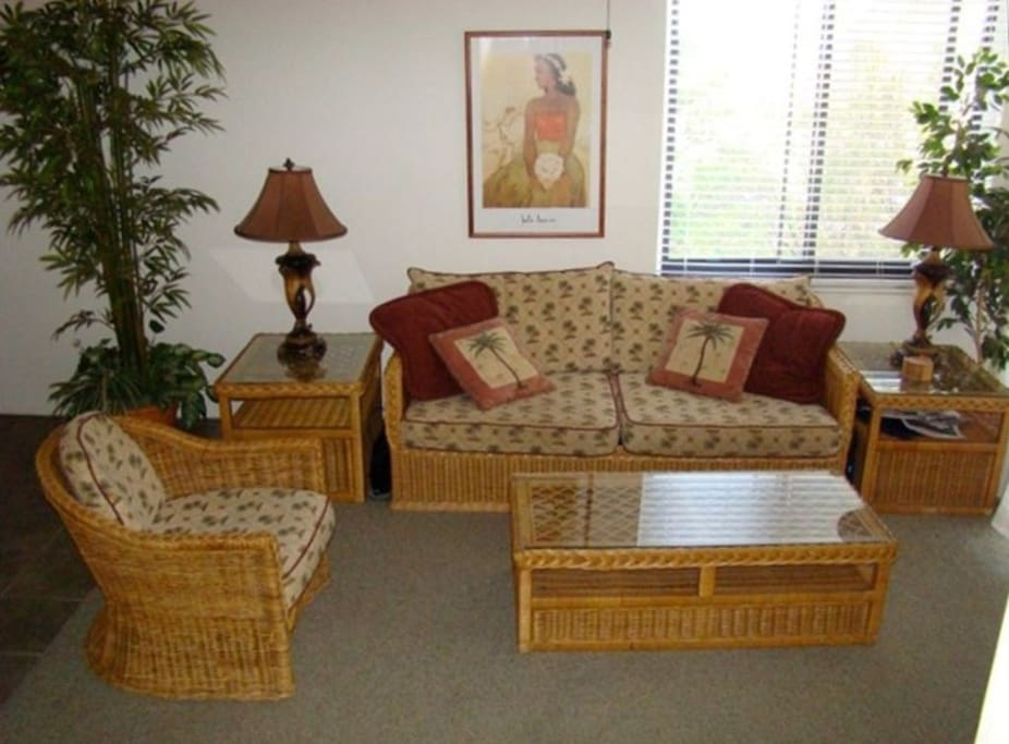 Hawaiian themed living space with air conditioning in every room & ceiling fans in every room.