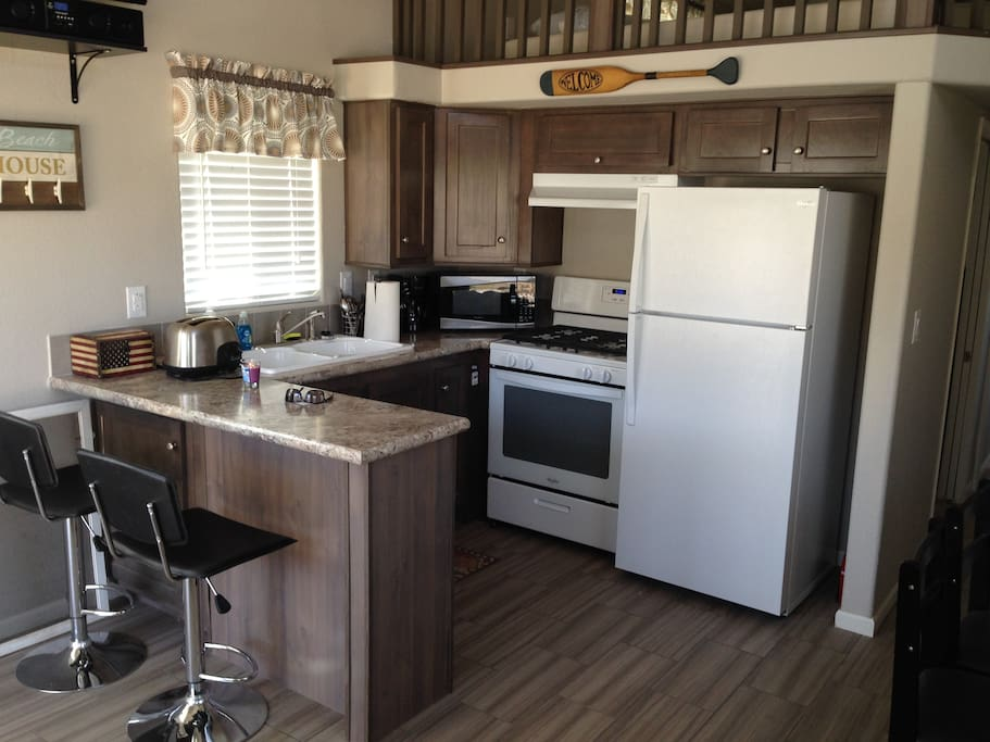 Kitchen has dishes, utensils, pots & pans, coffee machine, microwave, gas range and frigs.