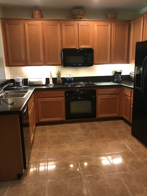 Large kitchen, granite counter tops. Kitchen is fully stocked and ready for your best cooking.