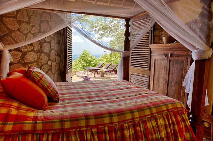 Relax or read while taking in the Petit Piton from the first floor bedroom. Experience bright Caribbean colored fabrics including Madras throughout the villa.