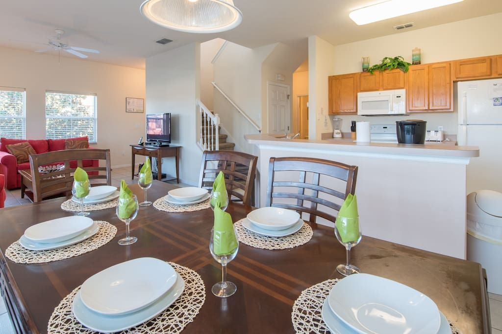 Dining area with service for up to 10 guests, and fully equipped kitchen