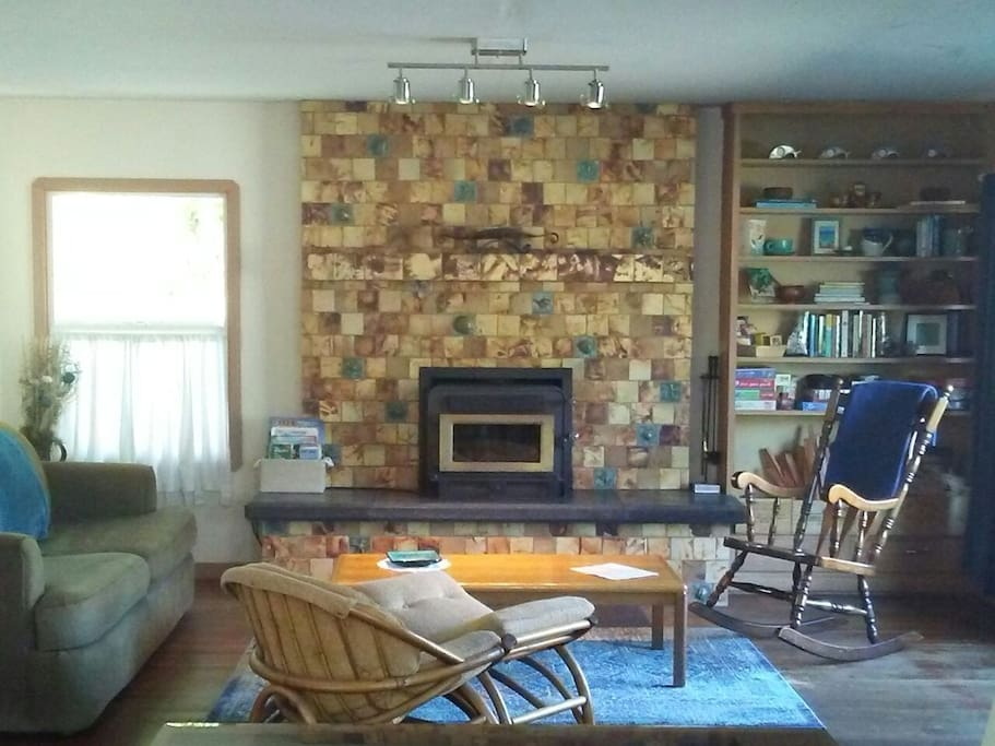 Living room with a beautifully tiled surround for wood insert by local tile maker.