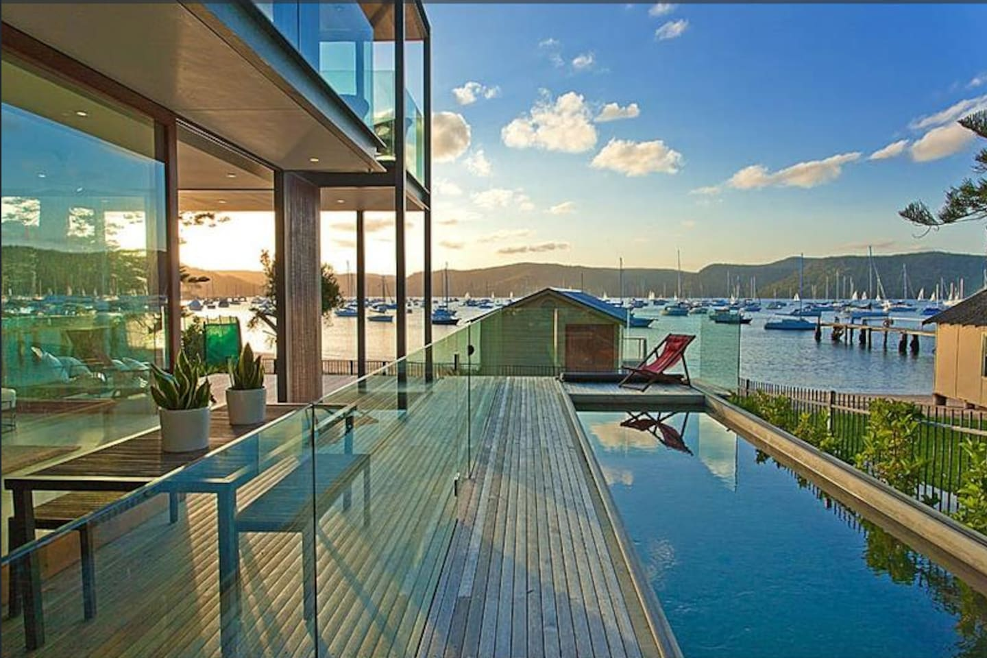 Absolute waterfront living on beautiful Clareville beach (previous owner's furniture)